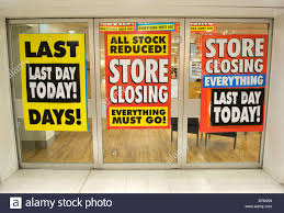 window posters store closing posters in the window of the woolworths store in