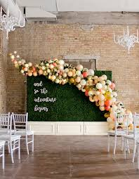 wedding backdrop balloons balloon installation on boxwood walls by girl friday girl friday