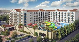 Home Plans With A Courtyard And Swimming Pool In The Center Harbor Blvd Hotels Near Disneyland Ca Courtyard Anaheim Theme