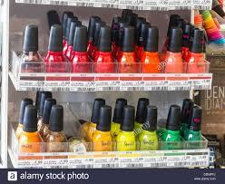 rows of spoiled brand nail polish bottles store interior usa