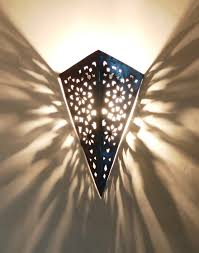 pierced iron moroccan wall light garden walls pinterest