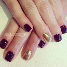 dark red gel polish with gold glitter accents fall nails nails