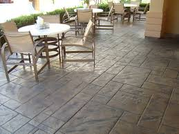Tiling A Concrete Patio by Thin Stamp Concrete Epoxy Floors Polished Concrete Self