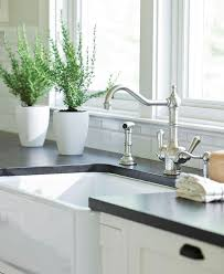 Farm Sink With Backsplash by Best 25 Black Granite Countertops Ideas On Pinterest Black