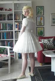 passion for pleats i love that dress blonde bouffant pinterest