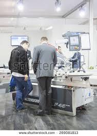 Woodworking Machinery Shows 2012 by Computer Connection Repair Concept Group Worker Stock Photo