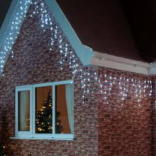 snowing icicle outdoor lights outdoor icicle lights warm white homebase outdoor designs