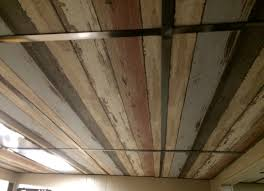 Do You Paint Ceiling Or Walls First by Cover Ugly Drop Ceiling Panels With Textured Wallpaper And Then