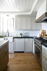 gray glazed white kitchen cabinets light gray cabinets with white glazed backsplash tiles