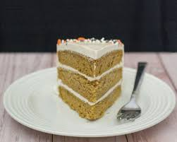pumpkin cake with salted caramel icing by the redhead baker
