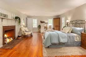 country master bedroom with hardwood floors built in bookshelf
