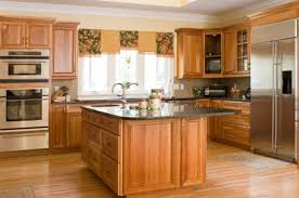 lacquered oak wood galley kitchen with square sink island of