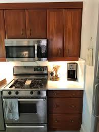 how to paint cherry wood cabinets cherry wood cabinets from 1990s what can i do to refinish