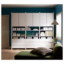 ikea ivar cabinets and drawers painted white and arranged into a