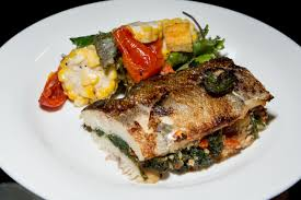 pan roast rainbow trout served with cornbread and mustard greens