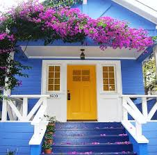 houses yellow door blue white trim floral vine pink house free