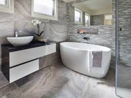 bathroom bevelled edged mirror freestanding bath tiles porcelain bevelled edged mirror freestanding bath tiles porcelain wall and floor glass and marble featurer shower niche silver feature tall basin mixer wall mounted