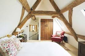 cottage bedroom a bedroom in loft space with exposed beams cottages houses