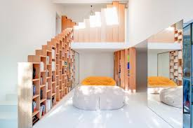 bookshelf house a bright and playful home outside paris