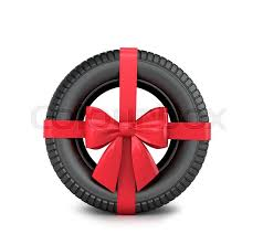 car ribbon car tire wrapped gift ribbon and bow on a white background