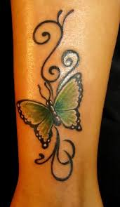 tribal green butterfly on leg tattooshunt com