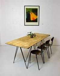 large vintage pine plank dining table with industrial metal legs