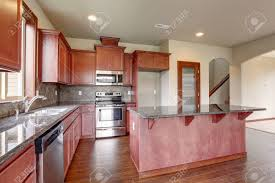 stained kitchen cabinets with hardwood floors traditional kitchen with hardwood floor island and stained