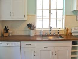 white wooden kitchen cabinet using dark brown wooden countertop