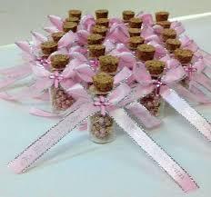 christening favors pink rosaries rosaries inside cork bottle christening favor