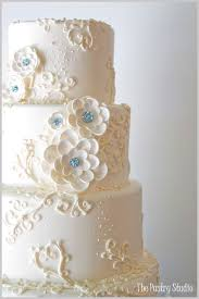a glamorous wedding cake with handmade sugar paste flowers using