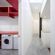 grade house in east vancouver delivers clean affordable design view in gallery modern minimal laundry room with a dash of red