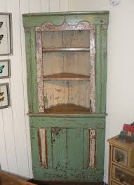 pine corner cupboard in original paint patina