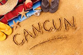 the word cancun written in sand on a mexican beach with sombrero