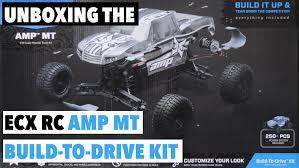 unboxing ecx amp mt 1 10 scale 2wd kit monster truck