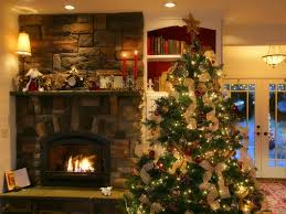 cool tips on decorating a christmas tree near fire place with red