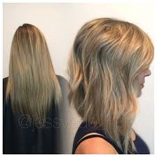 brown and blonde ombre with a line hair cut blonde textured a line bob with long layers and a beach wave style