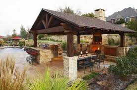 backyard pavilion kits outdoor living room with a fireplace