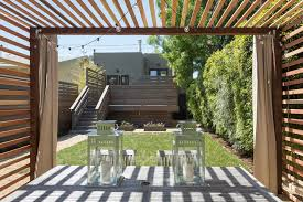 backyard covered patios patio modern with string lights patio