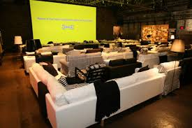 Movie Theater Sofas Rows Of Black And White Sofas And Chairs Served As Movie Theater
