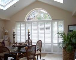 fetching palladium interior window shutters near round glass table