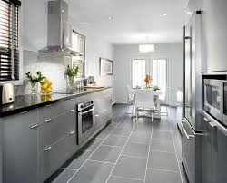 kitchen cabinets with gray floors grey cabinets with black counters wood floors countertops