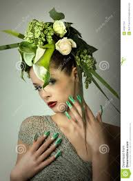 fashion model in green design and flowers and airbrush nails stock