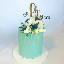 Tiffany Blue Baby Shower Cake - teal blue baby shower cake featuring a gold drip and fresh flowers