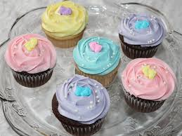 assorted pastel colored baby shower cupcakes with pearls amp baby