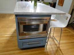 attractive kitchen island with microwave also a colorful light