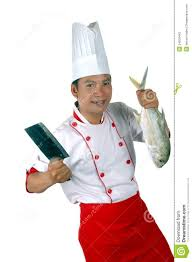 chef holding a big raw fish and kitchen knife stock photography