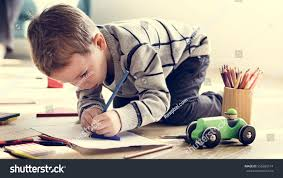 little kid drawing sketching cute adorable stock photo 555685174