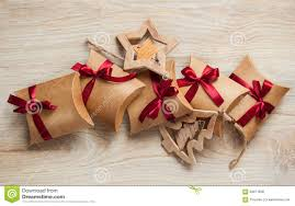 handmade christmas gifts from kraft paper and wooden toys on the