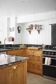 kitchen worktop ideas black worktop wood units country kitchen design ideas