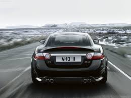 black jaguar car wallpaper black jaguar xkr rear speeding wallpapers black jaguar xkr rear